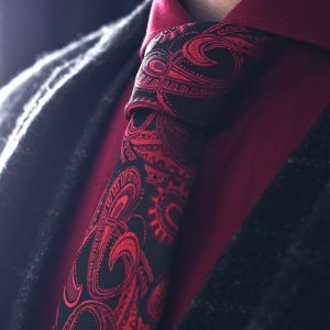 Black and red paisley necktie, made from silk for gentlemen