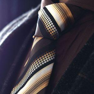 Brown, beige and creme silk striped tie