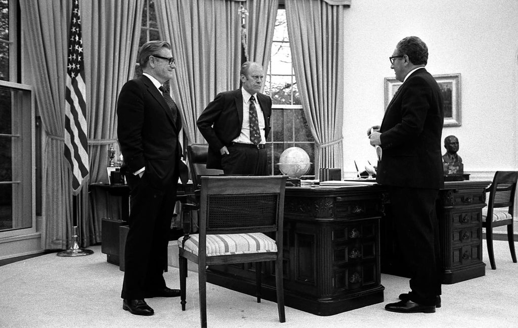 President Gerald R. Ford meeting in the Oval Office with Secretary of State Henry Kissinger and Vice President Nelson Rockefeller to discuss the American evacuation of Saigon.