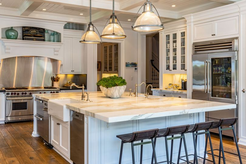 Chef's kitchen with marble island