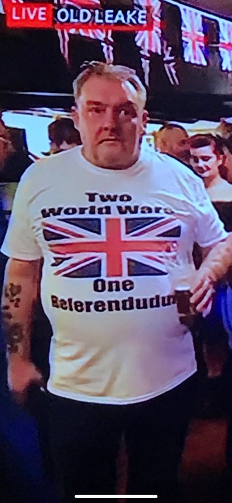 Brexit man with one t-shirt saying, two world wards, one referendudum