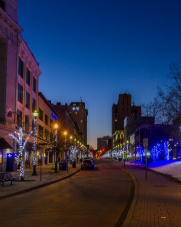 The horizon begins to brighten on downtown Grand Rapids and Rosa Parks Circle.