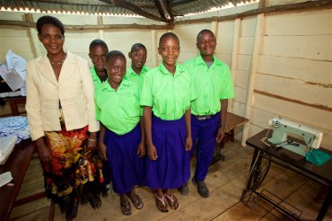 This is Sarah Napuga Nalongo, the teacher at the tailoring school. Sarah is the mother of three sets of twins and does amazing job of teaching her students how to sew.