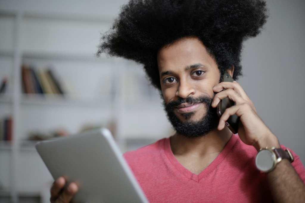 Guy on phone w BCBS