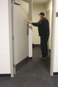 Jason Doyle going into a locker room at Membertou