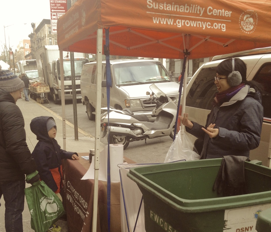 dropping off compost at a New York greenmarket