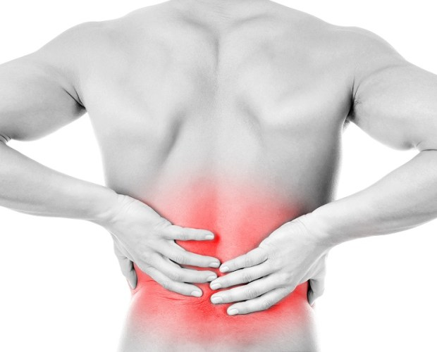 Person hurting with back pain on the move