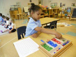 Girl doing Montessori Stamp Activity