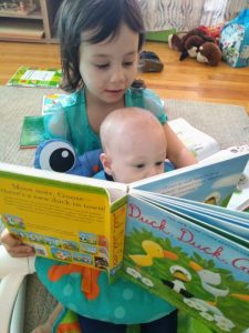 child reading to baby