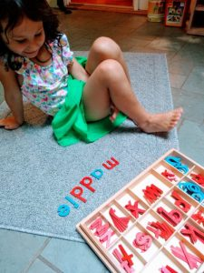 Child working with Montessori Movable Alphabet