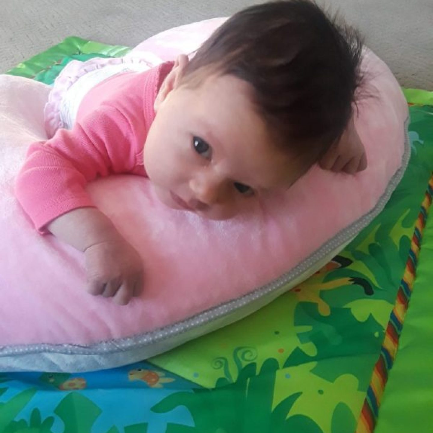 baby laying on boppy pillow