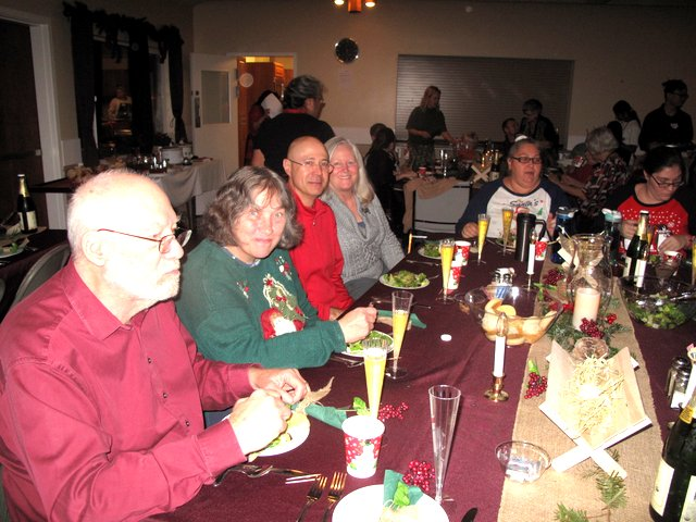 Party goers enjoy their salads
