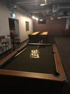Sports room in Preston's Level, with pool table and shuffleboard tables