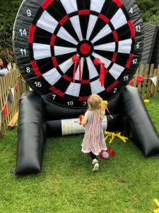 Spike playing giant inflatable darts at Southport Flower Show