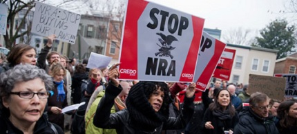 Protesters gather outside the DC office of the NRA, which has called for guns in schools. (photo: Tom Williams/Roll Call/Getty Images)