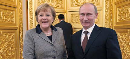 Angela Merkel and Vladimir Putin. (photo: Alexei Nikolsky/AP)