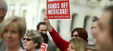 Protester holds Medicare sign. (photo: Fifth World Art)