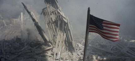 An American flag near the base of the World Trade Center after the attacks of September 11, 2001. (photo: Peter Morgan/Reuters)