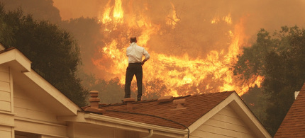 Fire near suburban homes. (photo: David McNew/Getty Images)