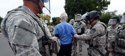 Daniel Ellsberg is arrested during a demonstration to protest nuclear weapons outside the gates of the Lawrence Livermore National Laboratory in Livermore, Calif., on Thursday, Aug. 6, 2015. (photo: Kristopher Skinner/Bay Area News Group)