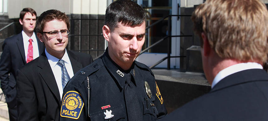 Officer Stephen Rankin leaves the US district court building in Norfolk, Virginia with his attorneys in February 2012. (photo: Brian J Clark/The Virginian-Pilot)