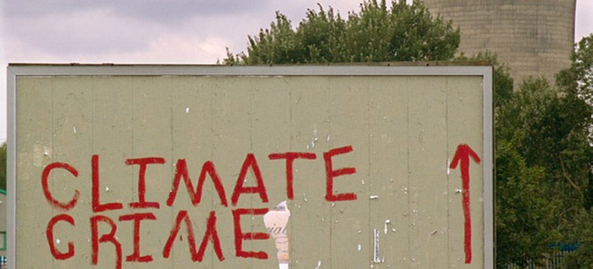 Climate change activists' graffiti on a billboard near the Didcot coal-fired power station in Oxfordshire, UK. (photo: Tim Myers)