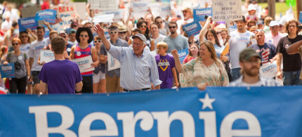 Senator Bernie Sanders and his wife Jane O'Meara Sanders march with supports at the Independence Day Parade in Waukee, Iowa. (photo: Arun Chaudhary)