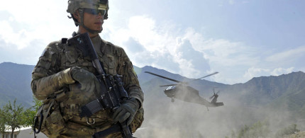 A U.S. soldier secures a landing zone for a Black Hawk helicopter in the Shigal district center in Kunar province, Afghanistan. (photo: Getty)