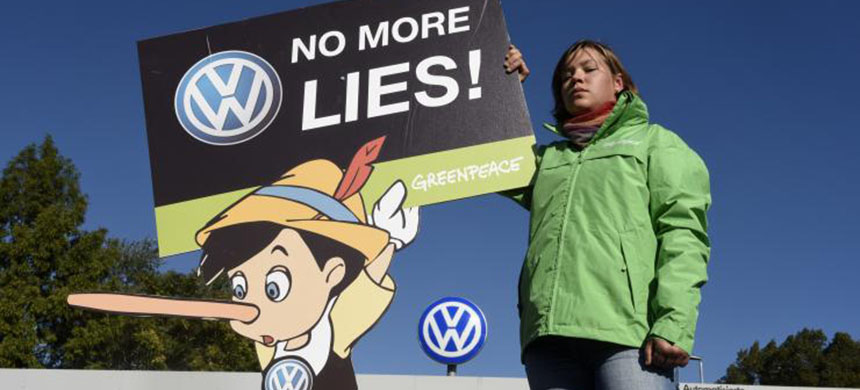 A Greenpeace activist holds a banner during a protest in VW's home of Wolfsburg, Germany, September 25, 2015. (photo: Fabian Bimmer/Reuters)