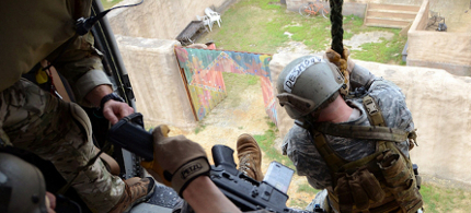 US Army Special Forces are seen doing training exercises at the John F. Kennedy Special Warfare Center and School on Fort Bragg, North Carolina, not unlike the kind of exercises done at military bases the world over. (photo: USAOC News Service/Flickr/Creative Commons)