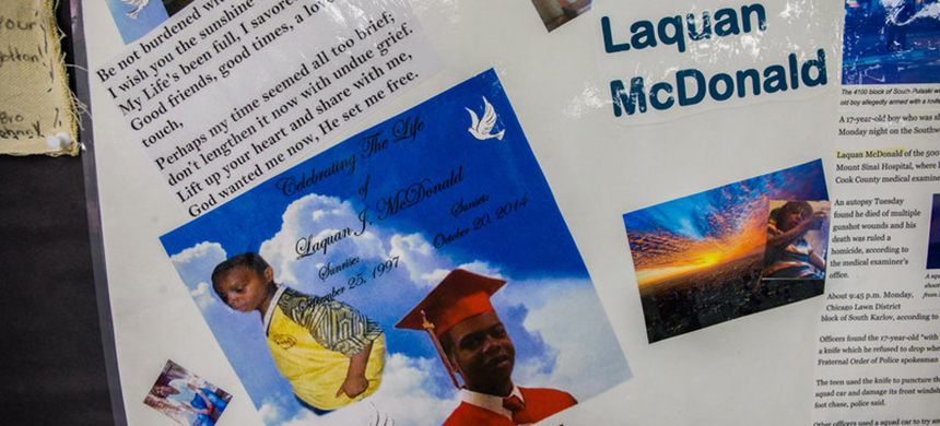 A memorial to Laquan McDonald, 17, is seen in April at the Sullivan House Alternative High School in Chicago. McDonald was shot 16 times by Chicago police Officer Jason Van Dyke in October 2014. (photo: Zbigniew Bzdak/TNS/Landov)