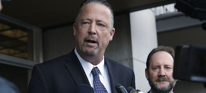 San Francisco police Sgt. Ian Furminger (left) speaks to press in back of the Phillip Burton Federal Building & United States Courthouse in San Francisco in February. At right is his lawyer Brian Getz. (photo: Liz Hafalia/The Chronicle)