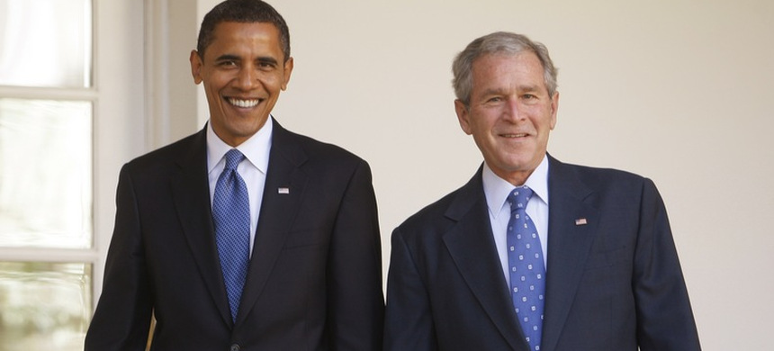 Barack Obama with George W. Bush. (photo: AP)