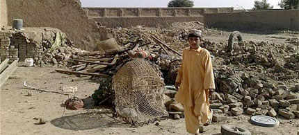 A boy stands at the site of suspected US drone attacks in the Janikhel tribal area in the Bannu district of Northwest Frontier Province in Pakistan, 11/19/08. (photo: Reuters)