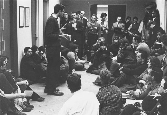 Photographer Danny Lyon identifies the figure standing and speaking as Bernie Sanders. Others dispute it. Everyone agrees Sanders was there and a principal organizer of civil rights demonstrations at the University of Chicago. (photo: Danny Lyon)