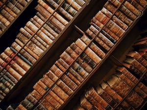 Three rows of books in very old bindings pictured on the diagonal.