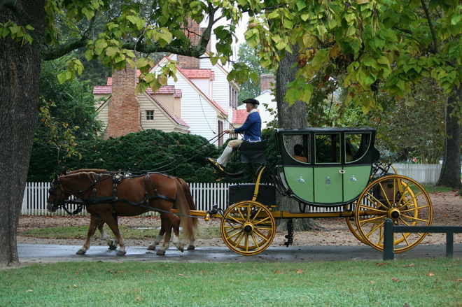 Green Coach pulled by two brown horses. Brings to mind Dickinson's strange carriage ride.