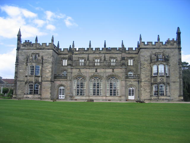 Shows large gray stone mansion Arbury Hall, its estate managed by George Eliot's father.*