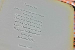 "Photo of page of book showing Frost's poem ""Fire and Ice"""