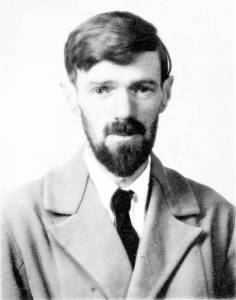 Passport photo from 1920s or 30s showing young man with dark hair and pointed beard, wearing a coat with wide lapels and a black tie.