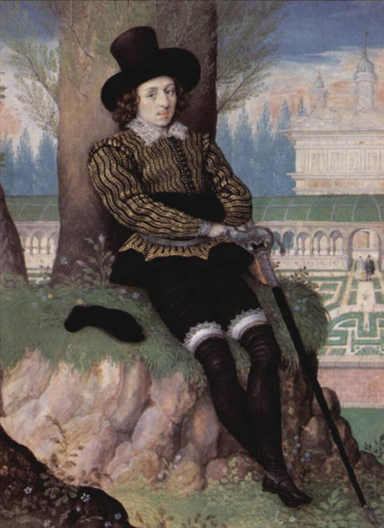 Young Renaissance man is seeated on a hillock under a tree, looking elegant in black boots and breeches and a gold and black short jacket with a white lace collar. Shows how Renaissance English men strove to look.