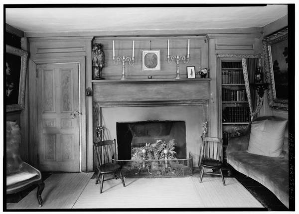 1930s B & W photo documents the sitting room of the Old Manse, showing the stuffed owl Hawthorne recovered from the attic. It's still there!