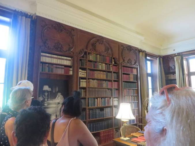 Tourists gaze at Edith Wharton's impressive library, which offers just one example of the authors' love for books I saw on this tour of homes.