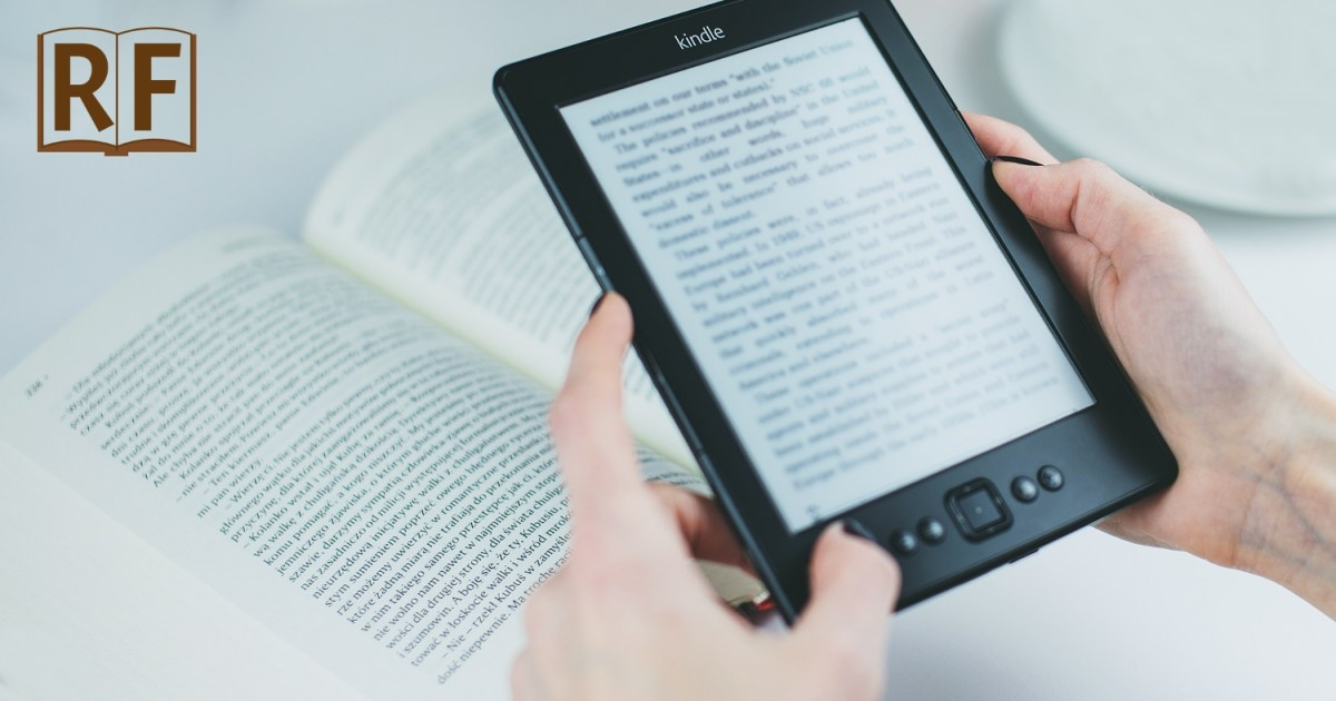 hands holding a Amazon Kindle with a print book in the background
