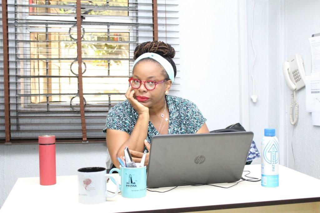 anwuli ojogwu of narrative landscape press sits at office desk