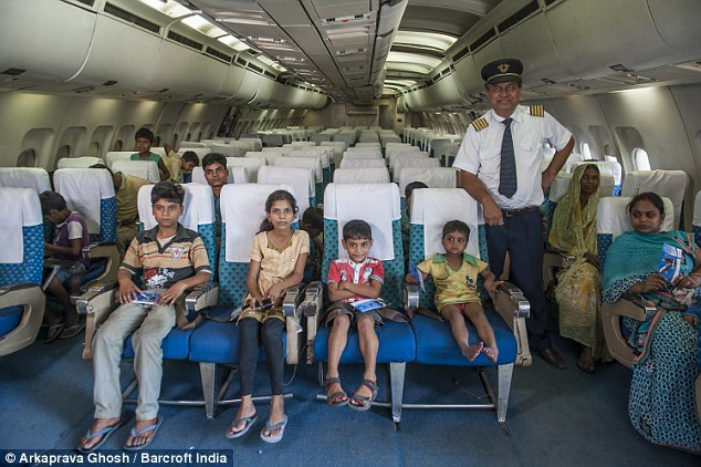 The captain, Gupta along with the passengers.