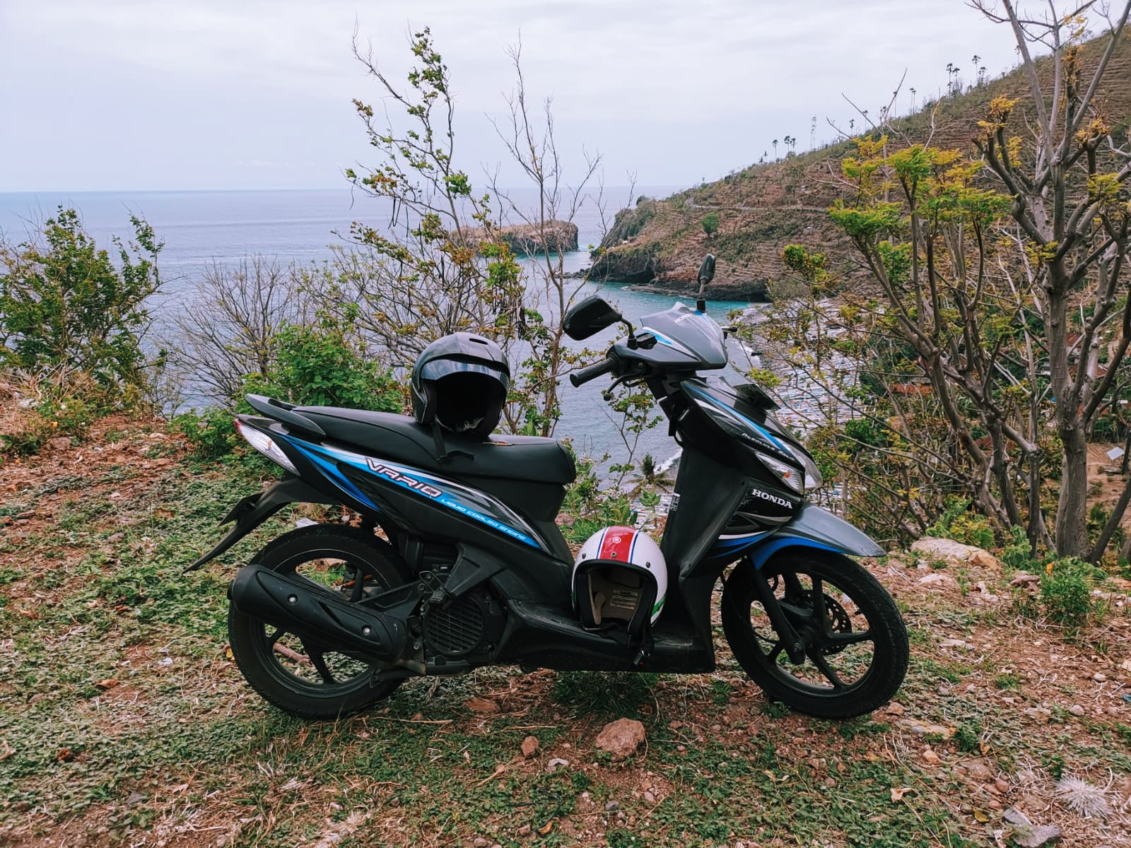 Pura gili selang pointview in Amed Bali, with our motorbike. 12 things to do in Amed Bali