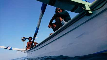 Indonesian fishing boat fisherman in the balinese coast who became guide.