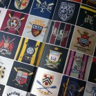 The front and back inside cover is made up of all the crests of the boat clubs featured in the book.