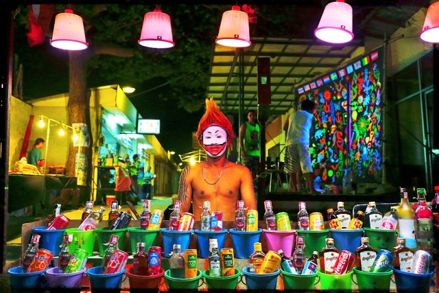 Full Moon Party vendor selling buckets of booze